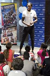 Toronto Raptor DeMarre Carroll speaks to students at Visa's launch of the new Marvel Comic book 'Guardians of the Galaxy: Rocket's Powerful Plan' at the Toronto Public Library's Sanderson branch.