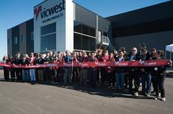 Paul Lobb, President of Vicwest Building Products, opens the new Centre of Excellence manufacturing facility in Acheson, Alberta with Vicwest employees on September 21, 2016.
