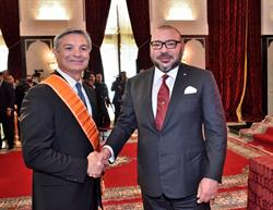 Morocco's King Mohammed VI (right) shakes hands with Raymond L. Conner, Vice Chairman of The Boeing Company and President and Chief Executive Officer of Boeing Commercial Airplanes, at a ceremony in Tangier, Morocco held September 27, 2016.