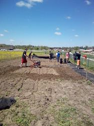 Members of the Cedar Springs, Michigan FFA chapter, seen tilling soil, used Grants for Growing funding to purchase tools and supplies for a community garden.
