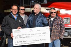"""Photo (Left to Right): Alliance Pipeline representatives Rob Gray and Paul Moen present Grand Coulee Fire Chief, James Pratt, and Grand Coulee Sk. Mayor, Irvin Brunas, with $5,000 towards a new """"Jaws of Life"""" in the first donation made through the company's safety-focused community investment program."""