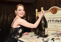 Emma Stone Signs Champagne Taittinger Bottle
