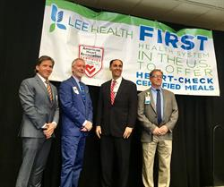Lee Health is the first health care system in the U.S. to offer American Heart Association® Heart-Check Certified meals to patients, visitors and employees. The announcement was made during a press conference in Fort Myers, FL: (left to right) Kevin Billings, National Director, Heart-Check Certification program; David Markiewicz, Executive Director, Greater Southeast Affiliate, AHA; Larry Antonucci, MD, President & CEO, Lee Health; Larry Altier, System Director, Lee Health Food & Nutrition Services.