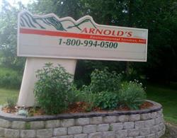 BEFORE picture of Anrold's old letterboard sign which was very cumbersome and would often show outdated messages, because it rarely got updated.
