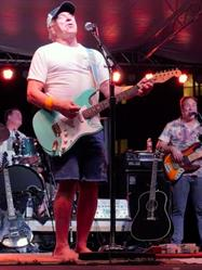 Jimmy Buffett performs with Parrot Heads In Paradise Founder Scott Nickerson