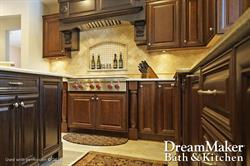 A kitchen remodel is displayed with a dark wood finish on the cabinets and an inset spice rack on th