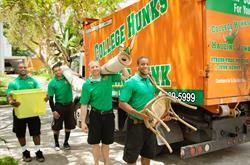 Four Hunks moving household items into a CHHK truck