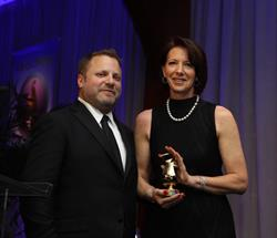 Med Ad News Person of the Year, Dana Maiman, CEO and president of FCB Health, accepts her statue at last night's 2017 Manny Awards