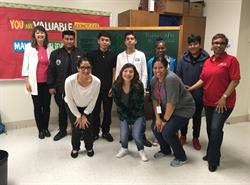 PMI Dallas and Skyline High School students team to complete a project.
