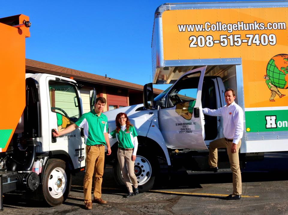 Scott, Cheryl and Austin Baker standing in front of their moving and junk trucks