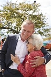 Peter Gilgan, founder and CEO of Mattamy Homes hugs his mother Mary in front of St. Joseph's Health Centre. Gilgan honoured his west end roots and his parents with a $10 million donation to St. Joseph's Promise Campaign on Thursday – one of the largest donations in the hospital's history.