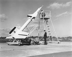Avro technicians prepare an Avro Arrow test model attached to a Nike booster rocket to fire out over Lake Ontario at Point Petre in the 1950s