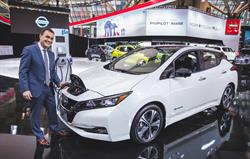 Nissan Canada Inc. president, Joni Paiva pictured with the all-new 2018 Nissan LEAF electric vehicle and FLO home charging station.