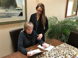 Judy Peterson and Kim Nicholls, signing consent for MPI